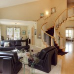 Great Room with Sweeping Staircase