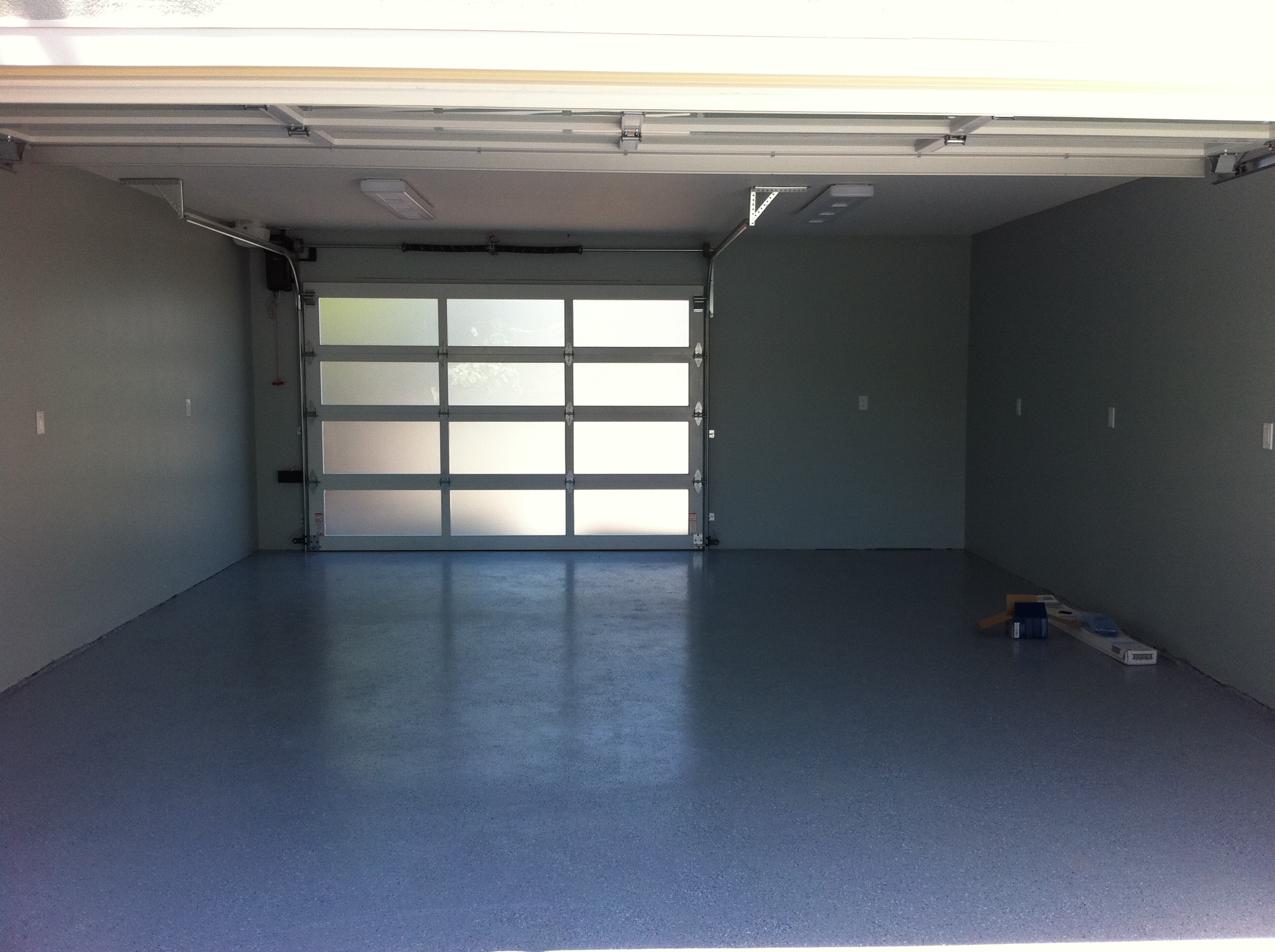 Glass garage doors add light to a los gatos garage for Front and back doors